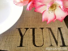 Idea: stencil each family members initials in the corner.  A complete photo tutorial for Burlap Stenciled Placemats