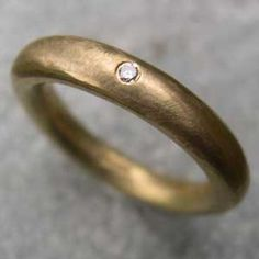 single diamond eternity ring in 18ct yellow gold