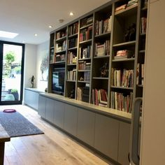 Random shelving with space for TV and cupboard storage below Rectangular Living Rooms, Bedroom Cupboard Designs, Cabinetry Living Room, Living Room Units, Living Room Storage Solutions, Media Furniture, Bookcase, Shelves In Bedroom, Cupboard Design