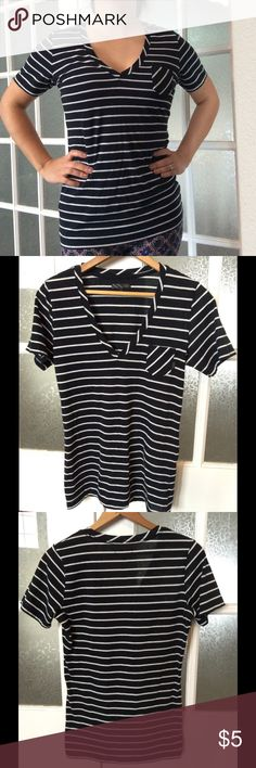"""Vans black and white stripe pocket tee medium This is a medium black and white stripes v neck pocket tee from Vans. Versatile shirt in excellent used condition. Flat measurements are 17"""" chest and 25"""" length. Model is 5' 2"""", 125 lbs, 34B. Vans Tops Tees - Short Sleeve"""