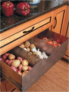 Check out this custom ventilated drawer to store non-refrigerated produce (tomatoes, potatoes, garlic, onions). (via myhomeideas.com)