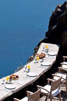 Breakfast is served with jaw-dropping views. Honeymoon Petra Villas (Santorini, Greece) - Jetsetter