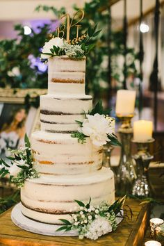 4 tier two flavor Bohemian Wedding Cake wth floral accent and laser cut topper by Sugar Bee Sweets Bakery #bridesofnorthtx #weddings #cake