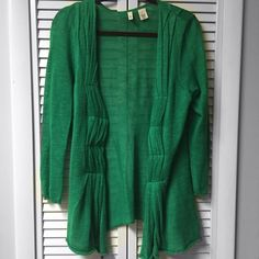 Anthropologie Moth Cardigan Anthropologie Green Moth Cardigan...Sz. M... Eyelet closures...So great with a pair of jeans and you are ready for St. Patrick's Day...Buy 3 closet items get 15% discount  Buy 5 closet items get 20% discount   All clothes ship clean and are smoke free home.  All proceeds from sales are going to help two minor children who lost their single mom in a recent tragedy  Thank you. Have a beautiful & blessed day. Anthropologie Sweaters Cardigans