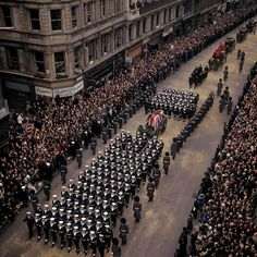 24 January 1965: Sir Winston Churchill dies at the age of 90. The gun carriage bearing his coffin is pictured on its way through central London to St Paul's cathedral for the funeral service, held on 30 January 1965.