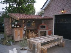More pizza oven ideas! Love the outdoor kitchen set-up under roof.