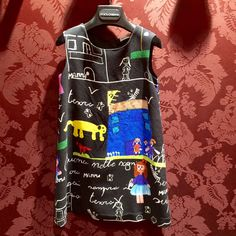 A black background variation of the script dress for kids fashion at Dolce & Gabbana
