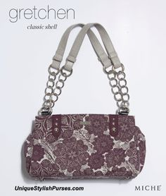 Abstract flowers in a gorgeous shade of deep plum dance across a light grey background, making the Gretchen Shell Classic #Miche #HandBags an instant head-turner. #purses