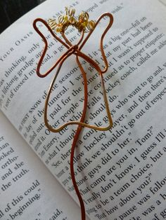 Copper wire angel bookmark could be a helpful gift to someone that has recently lost someone.
