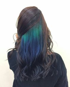 Under a bright and sunny day, this inner hair color design can almost capture the beauty of northern lights.