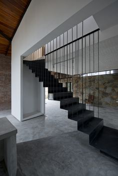 Image 15 of 25 from gallery of Folded Roof House / TOOB STUDIO. Photograph by Lê Anh Đức