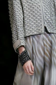 Laser cut leather jacket with scaly textures in grey taupe; runway fashion details // Giorgio Armani Spring 2015