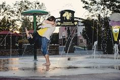Engagement photos in fun fountain