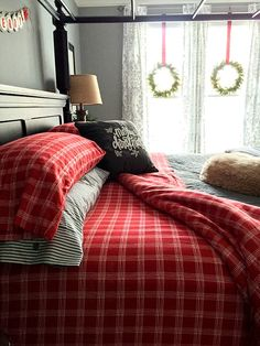 Master bedroom with reds and grays at Christmas