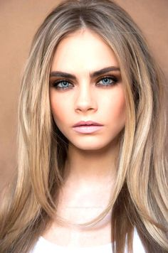 natural blonde hair and smoldering neutral eyes, nude lips and pale skin! <3