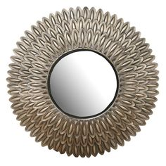 Wall mirror in antiqued gold with a layered startburst silhouette.     Product: Wall mirror    Construction Material: