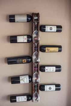 Handmade Wood Wall Mounted Vertical Wine Rack holds 9 bottles and 4 wine glasses The wine rack is made of pine, carefully hand crafted in the Industrial Wine Racks, Wood Wine Racks, Wine Rack Wall, Bottle Rack, Wine Bottle Holders, Wine Rack Design, Pallet Wine, Glass Rack, Wine And Beer