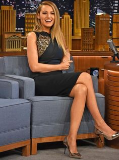 Blake Lively in an Antonio Berardi black and navy sheath dress with gold embellishments.