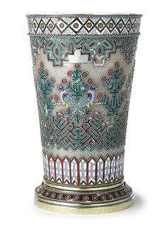 A Russian Silver and Enamel Large Beaker, Ovchinnikov, Moscow, 1872, of tapering form set on spreading foot, the body with cloisonné enameled Russian Style decoration of singing birds within flowering trees, the borders with geometric ornament. Height 8 1/4 in. 21 cm