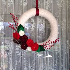 diy yarn christmas wreaths | Via Kelsey Logan