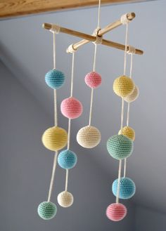 Crochet Pastel Baby Mobile - Colorful Ball Mobile(5-color mobile) - Kids room decoration - Newborn gift guide by YarnBallStories on Etsy https://www.etsy.com/uk/listing/126291149/crochet-pastel-baby-mobile-colorful-ball