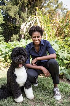 "First Lady Michelle Obama with ""First Dog"" Bo Obama in their White House garden"