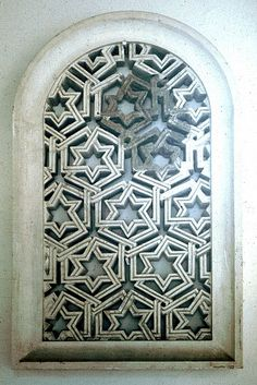 Image SPA 3010 featuring latticework from the Alcazabar, in Malaga, Spain, showing Geometric Pattern using stucco or plasterwork.
