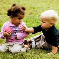 """What To Do About A Toddler Toy Taker?     Rather than jumping in immediately, Magda advised """"sportscasting"""" during conflicts – calmly and impartially stating just the facts to let the children know that we understand and empathize, i.e., """"Ben was holding that, and now Ella has it"""". Or, if a child seems upset, we acknowledge, """"It bothered you when Ella took the toy."""""""