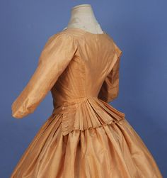 STRIPED SATIN GOWN. Whittaker Auctions says this dates to the 1770s, but it is almost identical in patterning to a 1790-94 dress in the Met Museum Collection.