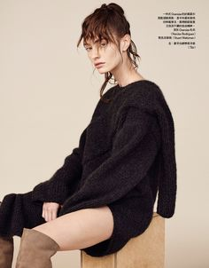Marine Deleeuw models Narciso Rodriguez oversized sweater with Stuart Weitzman over-the-knee boots
