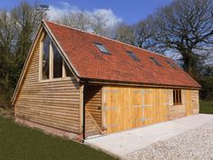 All our oak framed garages are bespoke; we do not impose any standard building sizes or styles:… Timber Frame Garage, Oak Frame House, Oak Doors, Garage Workshop, Garden Crafts, Garages, Stables, Modern Architecture, Buildings