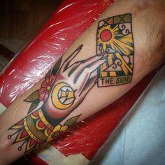 sun tarot #tarotcard #hand #handtattoo #tarotcardtattoo #tattoo #traditionaltattoo #realtraditional #brightandbold #boldwillhold #tattooworkers #tattoosandflash #tattoosnob #americanatattoos...