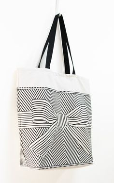 cool mix of graphic pattern with a bow.