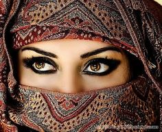 this is just truly a striking picture and a beautiful woman. I love the pattern and the eyemakeup