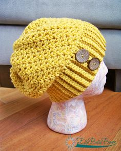 "A great trendy hat, the Melody Slouchy is made in this must have color, mustard. Notice Some great wood buttons were added to set off this hip look. This item is ready to ship, as is. It would fit a size 22"" head. If you would like to order a custom color, just contact me. This pattern..."