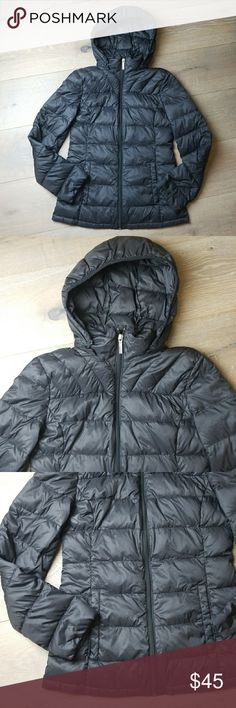 Michael Kors puffer down fill coat jacket Pre owned in excellent condition. Has a removable hoodie. All black in color. Has a zipper with the logo and left arm has a stamp logo. Very warm and light weight this is the packable style does not come with a storage bag tho. Michael Kors Jackets & Coats