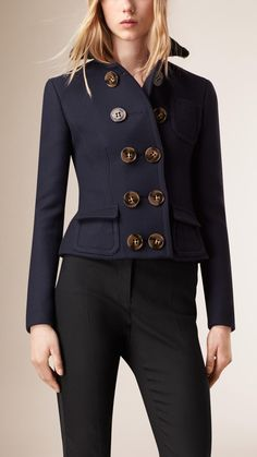 Perfectly tailored, this fitted blue jacket by Burberry has a smart, cropped silhouette. Crafted from the finest wool and silk-blend, this striking jacket features oversized horn-look buttons and a tapered waist with seam detail. Wear yours with elegant day dresses and stiletto-heeled pumps.