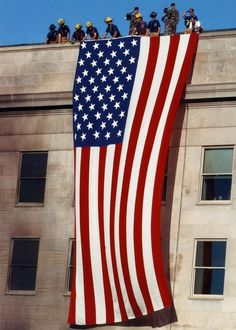 Flag on the Pentagon Sept. 12, 2001.  NEVER FORGET  NEVER FORGIVE  NEVER SURRENDER  AMERICA FOREVER