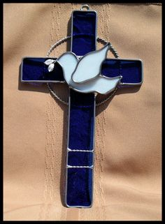 The cross represented on which Christ died and the dove as the symbol of the Holy Spirit.