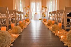 Flower combined with candles and petal scatterings at the side of the aisle.