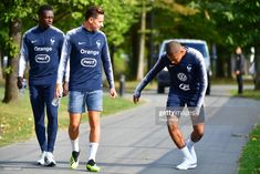 Photo d'actualité : Kylian Mbappe of France demonstrates something to...