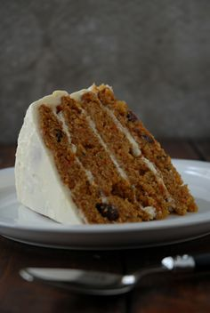 Carrot cake with pineapple chunks and raisins, coated in cream cheese frosting. Fluffy.