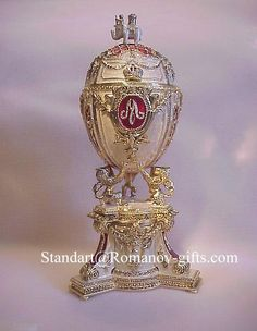 Romanov Eggs by Faberge   ... White Russian Music Box Egg with inner Faberge Egg Necklace surpise