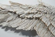"Susan Hannon's lyrical, ten-foot wide sculptures of ""wings"" are crafted out of abandoned Bibles, giving new life to books invested with emotion and courting more than a bit of controversy for the artist:"