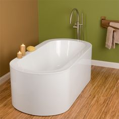 Sleek and spacious master bathroom tub.    http://www.signaturehardware.com/product18660    #signaturehardware #bathtub #master #bathroom