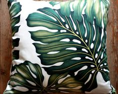 Bright green monstera leaves on an ivory cotton twill gives a fabulous fresh burst for your home, with the design featuring on both sides This cushion is the lumber shape and it is finished smartly with an invisible zip plus the price includes a feather insert. Check out my complete online store www.homeworksdesignstore.com to see the full range.