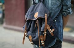 Rucksack Style Bag (backpack): A knapsack, often mounted on a lightweight frame, that is worn on a person's back. Usually made from canvas and leather. (Lau Yan Xin)