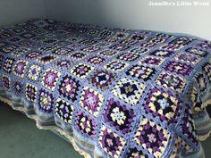 Crochet granny square blanket on bed