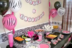 Zebra table decorations for an animal print party #animalprint #party #birthday
