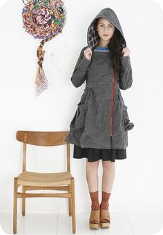 love this waxed canvas raincoat by Rebe.  I bought one of her dresses this summer at the artstar craft bazzar & tried on this jacket.  I'm still stalking it!